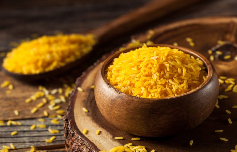 Raw Organic Yellow Saffron Rice in a Bowl
